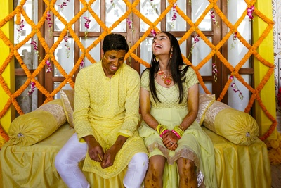 The couple sharing a light moment at the haldi