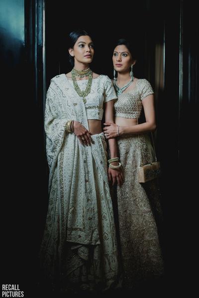 Bridesmaids in ivory lehengas