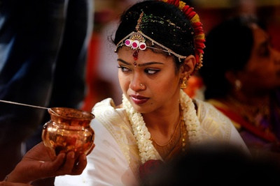 Bridal hairstyle adorned with a colorful juda and hair ornaments
