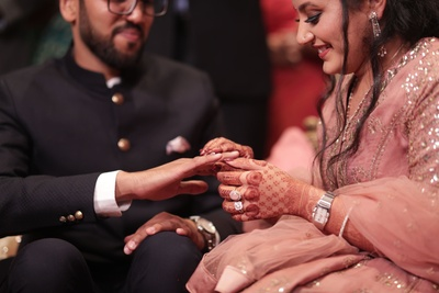 the couple exchanging rings at their engagement ceremony