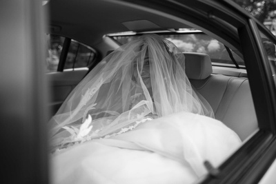 The bride behind a veil on her way to the church