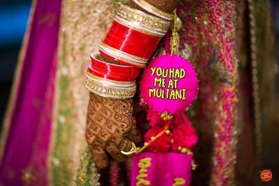 Customised latkans on the bride's pink lehenga for the wedding