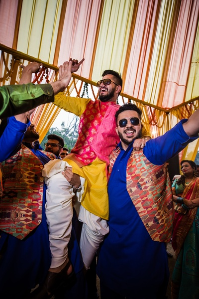 The groom having a great time at the Mehendi ceremony!