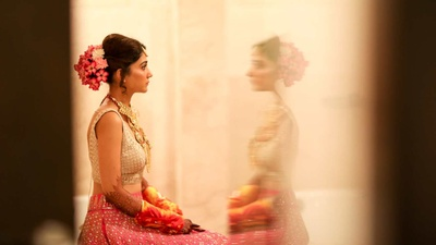 Traditional bride getting ready for the wedding in her Anita Dongre lehenga