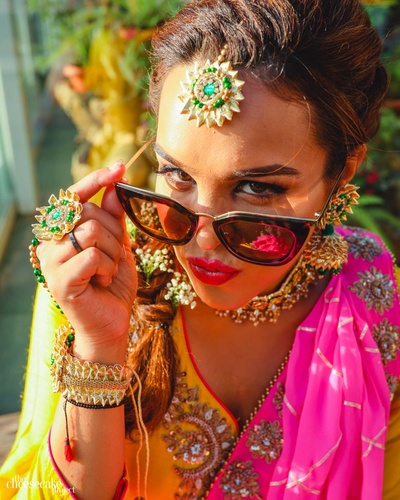 The cool bride pouting and posing at her haldi ceremony!