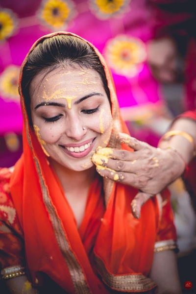 Glowing skin and red attire compliment the bride so perfectly !