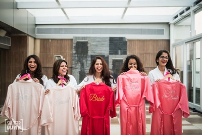 Bride and her bridesmaids pose for shutterdown photography at her pre wedding