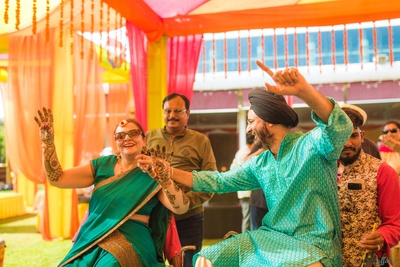 Family of the couple dancing during the mehdni function at Amer Greens, Bhopal