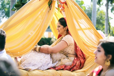 Bridal entry in yellow draped doli beautifully captured by Plush Affair photography!