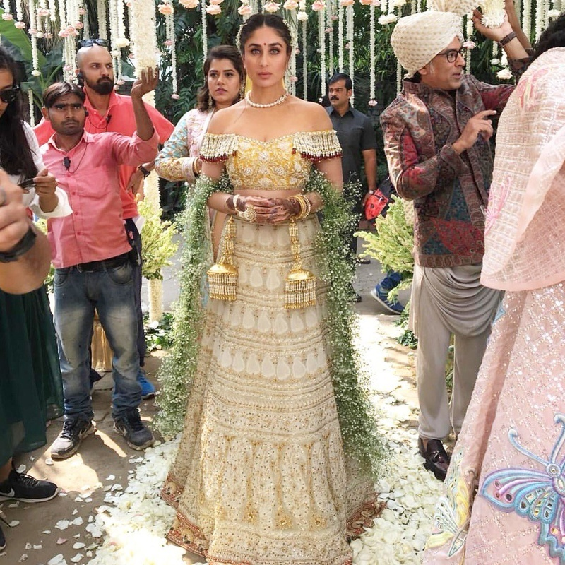 b8d9fe6f14 Kareena Kapoor stole all hearts in stunning off shoulder yellow and beige  with muted tones of red lehenga colour combination. This Abu Jani Sandeep  Khosla ...
