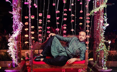 quirky poses struck by the groom during his sangeet function at Della Resorts, Lonavala