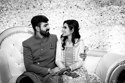 the bride and groom striking a romantic pose at their engagement ceremony