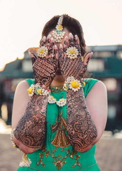 Intricate mehndi design for the bride's hands during the mehndi ceremony