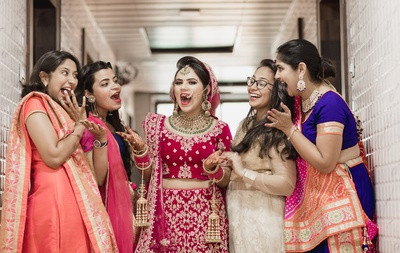 The bride and her bridesmaids having a fun time before the wedding ceremony commences!