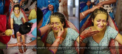 Vatna ceremony practiced in the punjabi community, in which the bride is made to sit across a holy fire, and turmeric paste in applied on to her face for a natural glow on her big day