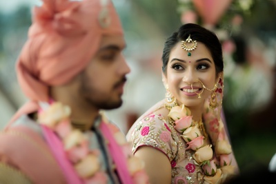 The bride looks almost mesmerized as she glances at her groom!