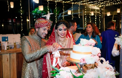 The couple together cut their wedding cake