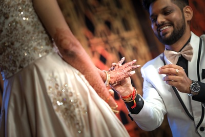 And this is the moment! The groom puts on the ring on his to-be-bride's finger!
