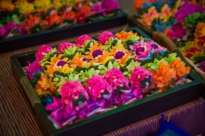 Floral corsages displayed for guests at pool party and mehndi function