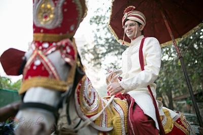 Ivory sherwani embellished with beads and thread work