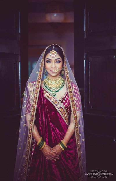 Krutika's fresh and dewy makeup with a bold eye and nude lips complete the bridal look