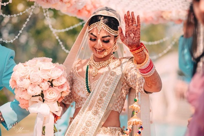 Bride dances during her bridal entry to the wedding mandap