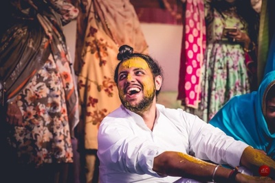 The groom looking dashing during the haldi ceremony in his crisp white shirt !