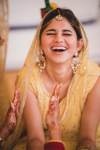 candid bridal photography for the haldi ceremony