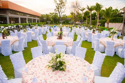 Elegant and chic pastel and white decor with floral centerpieces