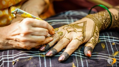 Twisted and tangled mehendi designs for arms
