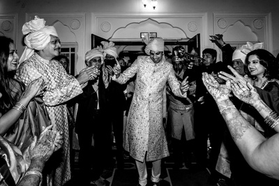The groom dancing his way to his wedding