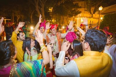 Baaratis enjoying with the groom, dancing on the beads of band-baja