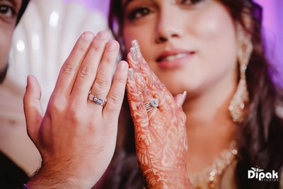Bride and groom show off their engagement rings at JW Marriott, Chandigarh