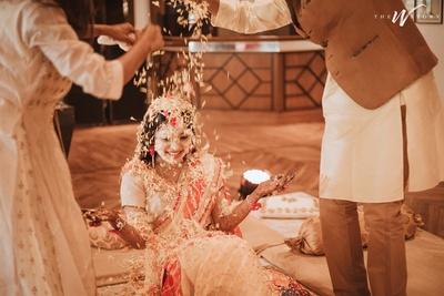 flower shower on the bride at the haldi ceremony