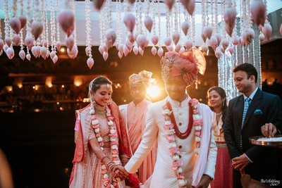 candid capture of the couple during the pheras