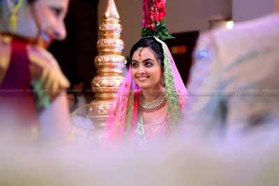 Blush Rose wedding lehenga styled with minimal polki studded necklace set with stone drops