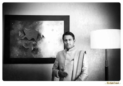 Decked in a designer wedding sherwani and a dushala