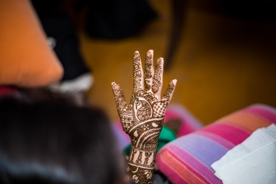 Intricate mehndi design for hands at the mehndi function