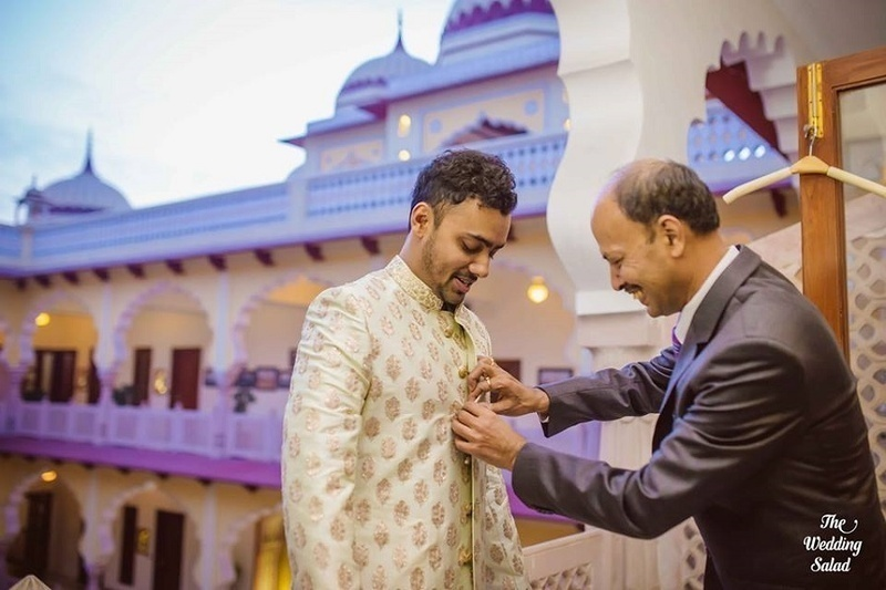 3.Groom suiting up: