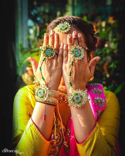 Beautiful floral jewellery worn by the bride on the day of her haldi