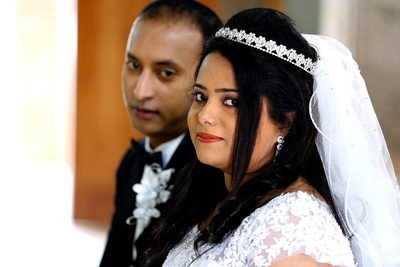 Bridal hairstyle adorned with diamond studded Tiara