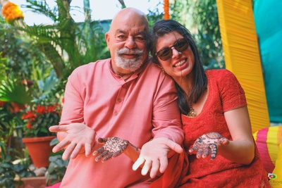 Bride and her father pose together during the mehndi function at a private Chattarpur farmhouse