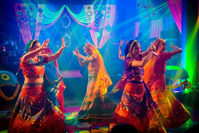 Traditional dance performance by dancers at sangeet function
