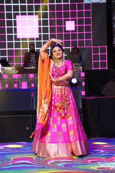 Candid capture of the bride performing at her sangeet ceremony