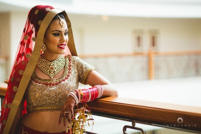 Decked up in a pretty red and gold lehenga by Aza for the wedding day !