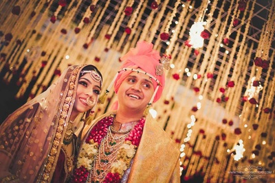 Candid bridal photo of the bride and groom post the varmala exchange