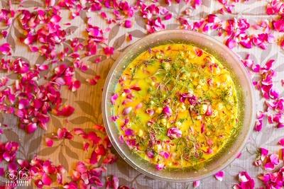 Haldi paste adorned with rose petals