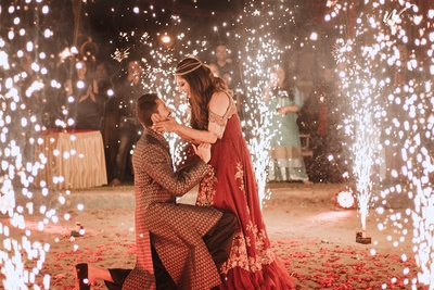 romantic picture of the bride and groom at the sangeet