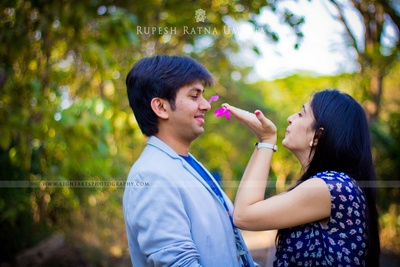 Creative pre-wedding photo shoot in coordinated sky blue outfits