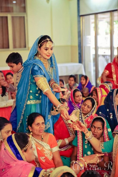 Typical marwari upper arm gold and white bangles accentuating the blue and gold ghagra choli